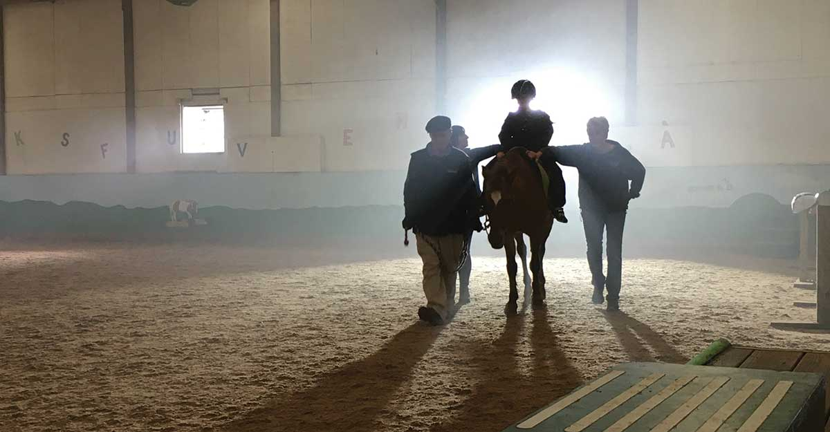 Girl riding a horse in a barn with trainers on either side. This broadcast commercial was produced by Current360 as part of a branding campaign that focused on the millions of dollars the Honorable Order of Kentucky Colonels provides to needy Kentuckians.